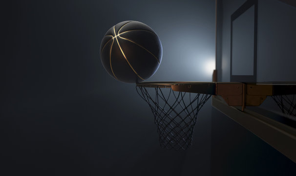 An action shot of a black and gold basketball teetering on the rim of a regular basketball hoop dramatically spotlit from behind on an isolated dark background - 3D render