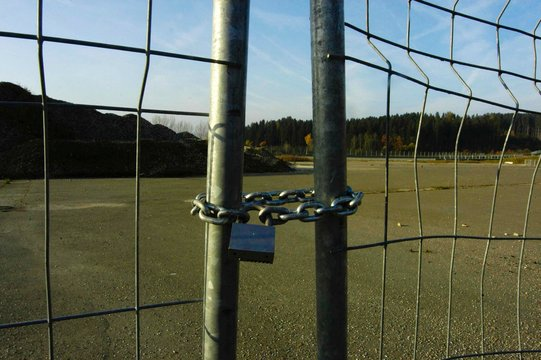 industrial crisis symbolized by locked gate