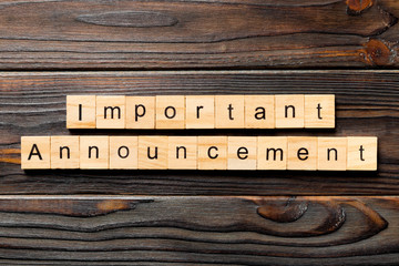 Important announcement word written on wood block. Important announcement text on wooden table for your desing, Top view concept