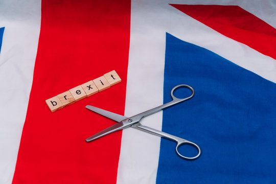 UK flag with the inscription brexit and scissors. Brexit in the UK