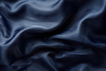 dark blue fabric with large folds
