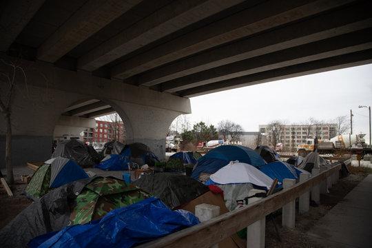 Homeless camp under bridge no sign
