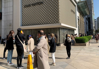 People queue to enter the Chanel boutique at a department store amid the coronavirus disease (COVID-19) outbreak, in Seoul