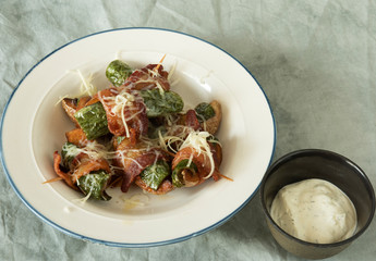 Bacon Wrapped Jalepeño Yukon Gold Potatoes in a Bowl Served with Ranch Dressing.tif