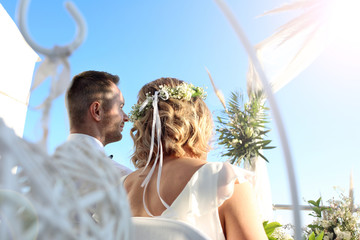 Wedding. A beautiful wedding ceremony under the open sky. A couple during a beach wedding ceremony.