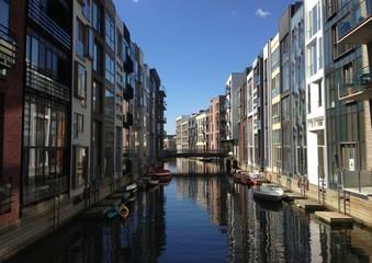 Fotobehang Kanaal Boats In Canal Along Buildings