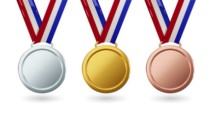 Vector gold medal with ribbon, set of isolated awards in realistic design. Symbol of victory and sporting achievements. Celebration and ceremony concept.