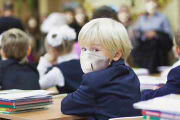 Child boy student in protective mask, back to school