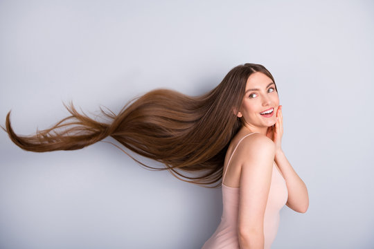 Profile photo of attractive cute model lady demonstrating ideal neat long healthy hairstyle flying on air after lamination procedure wear beige singlet isolated grey color background