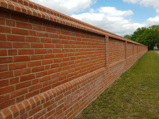 Cemetery wall, made of bricks at the Stöcken cemetery in Hanover, Germany