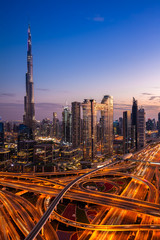 The view of the futuristic Dubai skyline and Sheikh Zaed road at dusk, UAE.