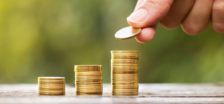Growing gold money coins and hand, financial services concept, web banner with copy space