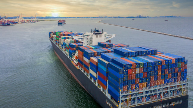 Container cargo ship, Freight shipping maritime vessel, Global business import export commerce trade logistic and transportation oversea worldwide by container cargo ship boat in the open sea.