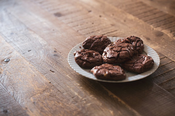 Dark chocolate cookies biscuits on a wooden table