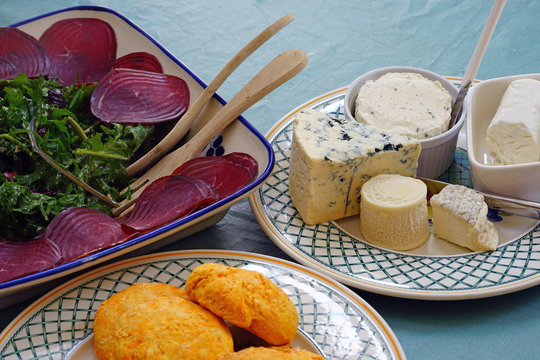 A gourmet cheese platter with ripened goat cheese and blue cheese