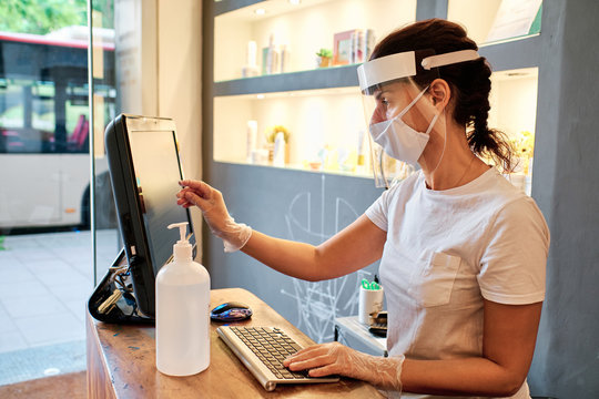 woman at desk using face mask - small business concept - coronavirus outbreak