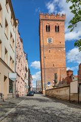 Zabkowice Slaskie, Poland. View of Leaning Tower (Krzywa Wieza) - medieval brick tower with clock
