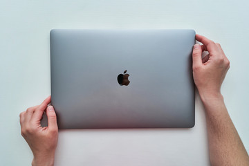 Batumi, Georgia - May 04, 2020. Macbook Pro 16 inch model of Apple brand of space gray colored in hands released in 2019