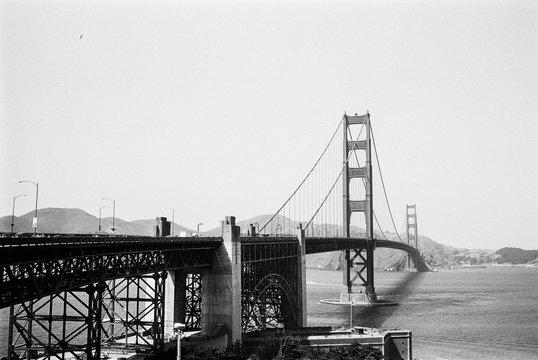 Golden Gate Bridge Over River Against Clear Sky