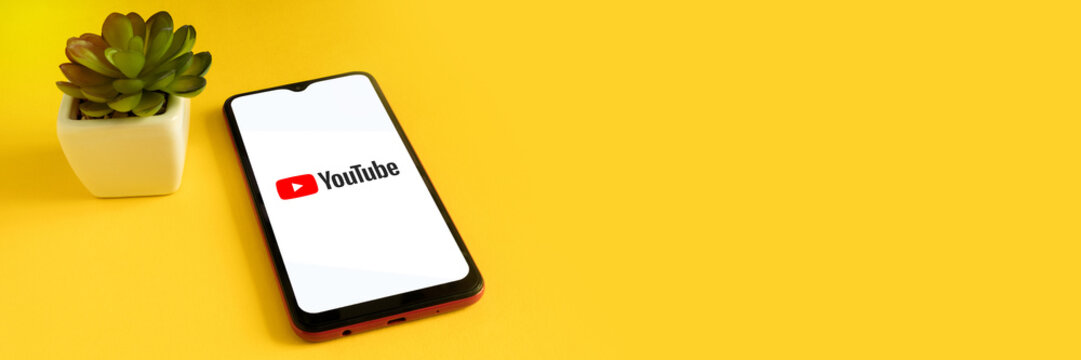 Minsk 12.05.2020. Smartphone on a yellow background with image of Youtube.