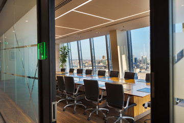 Modern urban conference room with long table and chairs