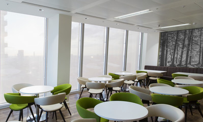Tables and chairs in office lounge