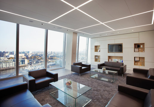 Modern highrise business office lobby overlooking city