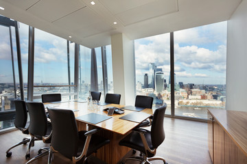 Modern highrise conference room overlooking city, London, UK