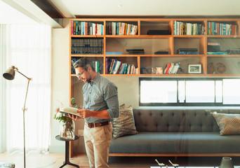 Man reading book in modern living room