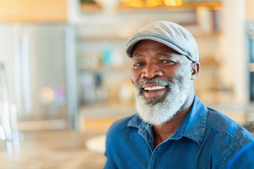 Portrait happy, smiling man with white beard