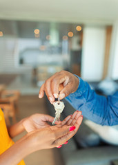 Close up man handing house keys to woman