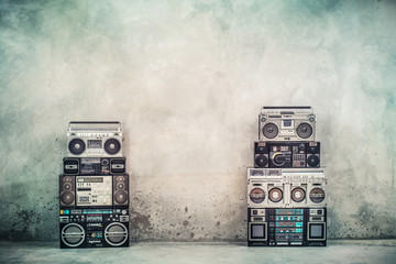 Retro old design ghetto blaster boombox radio cassette tape recorders from 1980s front concrete...