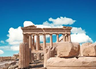 Fototapete - Parthenon temple on a bright day with blue sky and clouds. Panoramic image of ancient buildings in Acropolis hill in Athens, Greece. Classical ancient Greek civilization landmark, travel background.