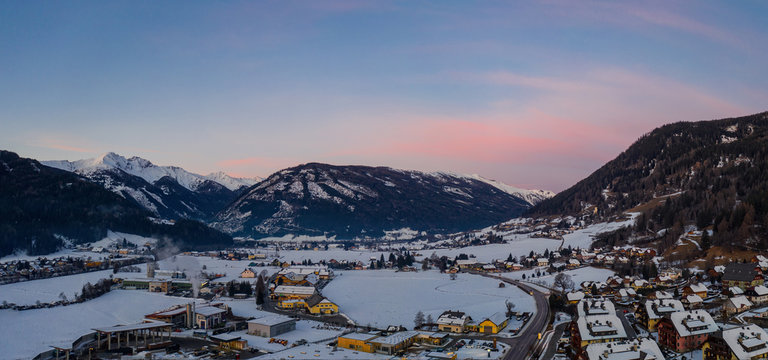 Panoramic view on Sankt Michael im Lungau at sunrise, Austria - January 2020. Aerial drone view.