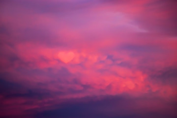 Photo Blinds Pink Beautiful sky at sunset. Purple and pink unusual heart clouds. Blurred background for design.