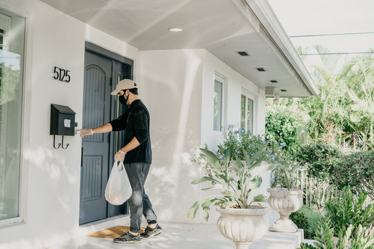 Food delivery man practicing social distance