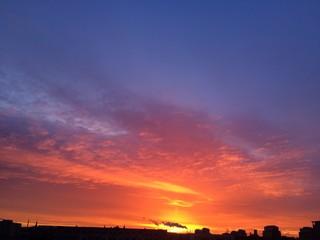 Foto auf AluDibond Rotglühen High Section Of Silhouette Landscape At Sunset