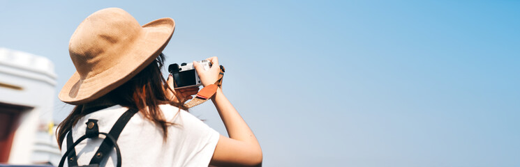 Young asian woman traveller with camera for banner size background. - fototapety na wymiar