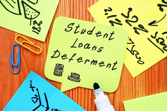 Student Loans Deferment  phrase on the piece of paper.