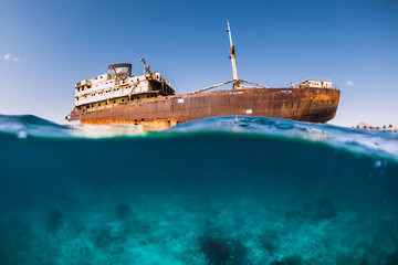 Telamon wreck ship in blue ocean. Arrecife city at Lanzarote