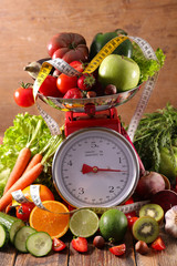 assorted of fruit vegetable on balance scale concept