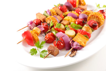 Wall Mural - vegetarian barbecue skewer with corn, tomato, tofu and onion