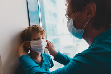 father put mask on son before going outside
