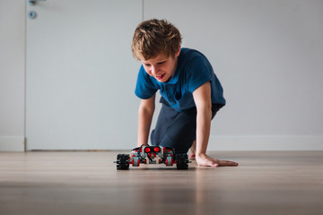 boy testing robot that he built at home, STEM for kids