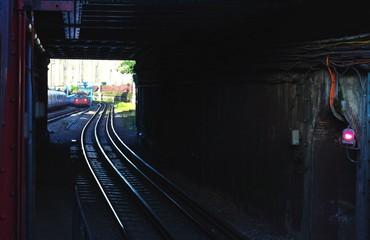 Spoed Fotobehang Spoorlijn Railroad Tracks In Tunnel