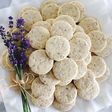 Purple Flowers With Pecan Shortbread Cookies On Table