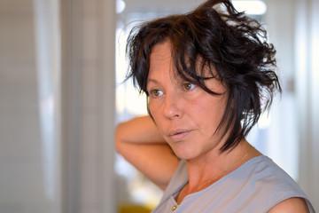 Hispanic woman with tousled dark hair