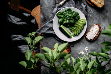 Salad with fresh spinach, avocado, cucumber and croutons on the table. Wall mural