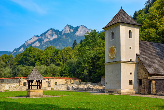 Stunning view of medieval Red Monastery (Cerveny Klastor), Slovakia. Three Crowns mountain range in the background