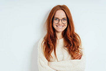 Happy vivacious young woman with long red hair